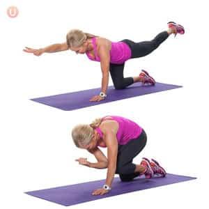 Chris Freytag demonstrating a Bird Dog Crunch on a purple yoga mat