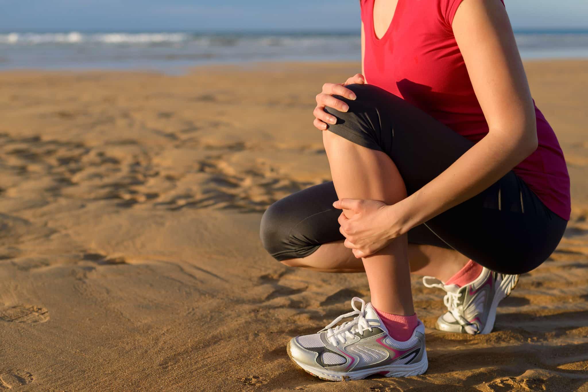 Woman holding shin splints shin pain.