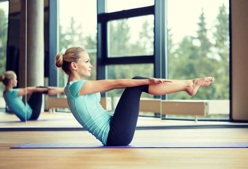 Use pilates moves like the full body roll up to reduce neck pain.