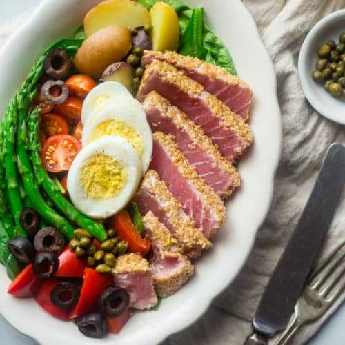 This whole 30 recipe for Asian Nicoise Salad with ginger vinaigrette is full of high quality protein and absolutely delicious!