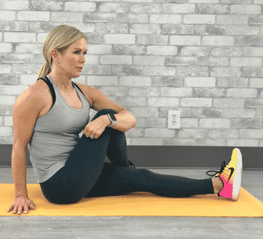 Chris Freytag demonstrating seated spinal twist